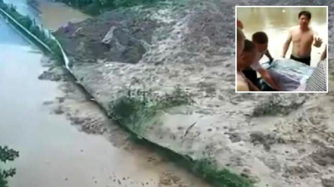Çin'de hamile kadın, sel felaketinin ortasında ortasında doğum yaptı